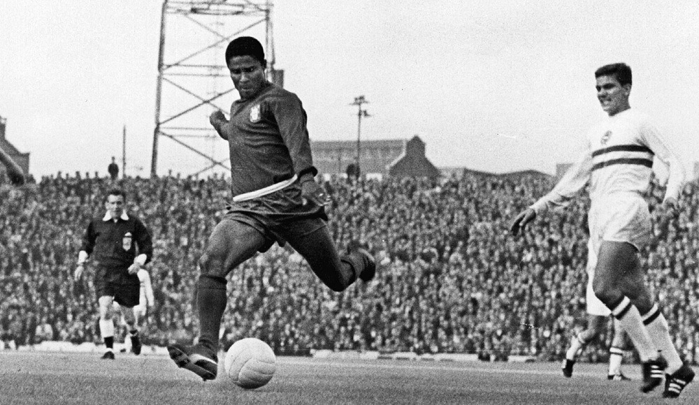 Football player Eusebio playing at the 1966 World Cup in England