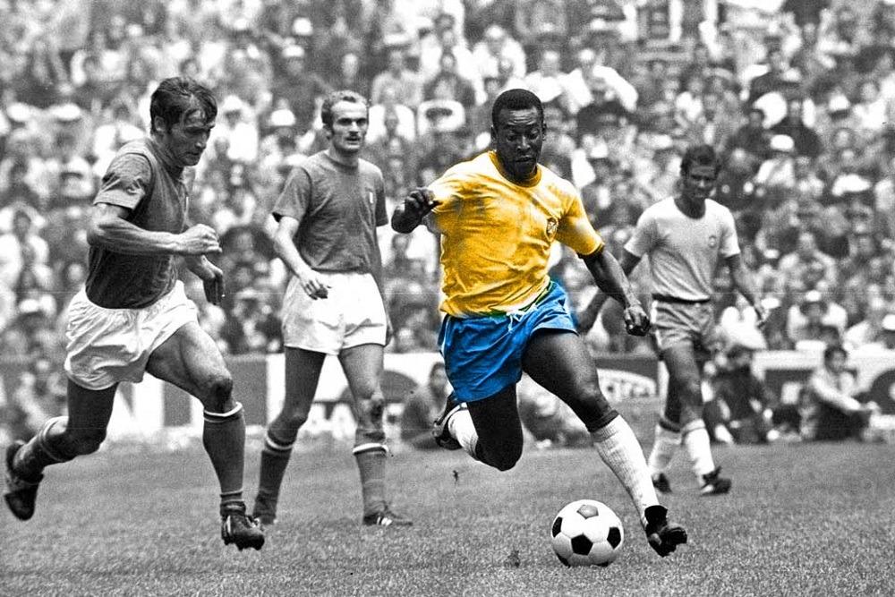 Football player Pele dribbling