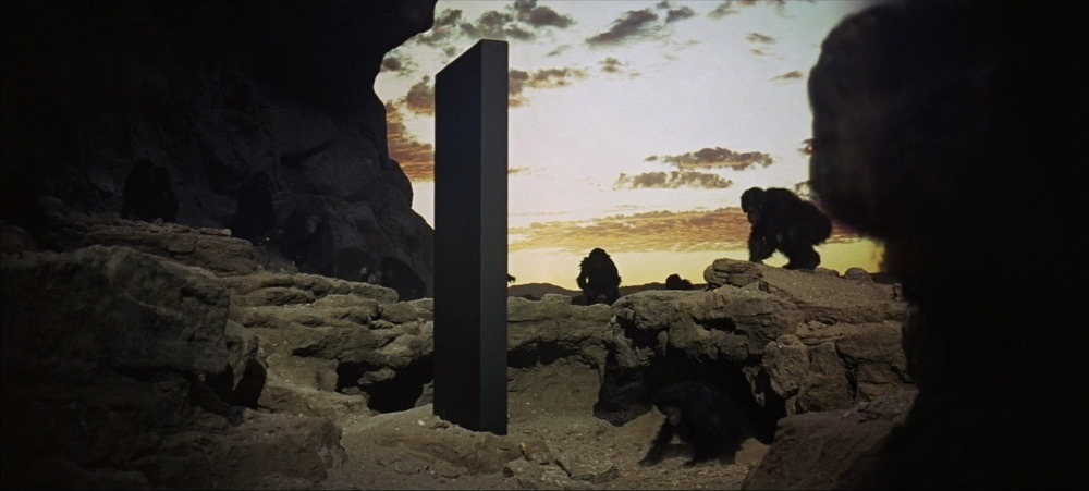 2001space odyssey with monkey staring at the black monolith